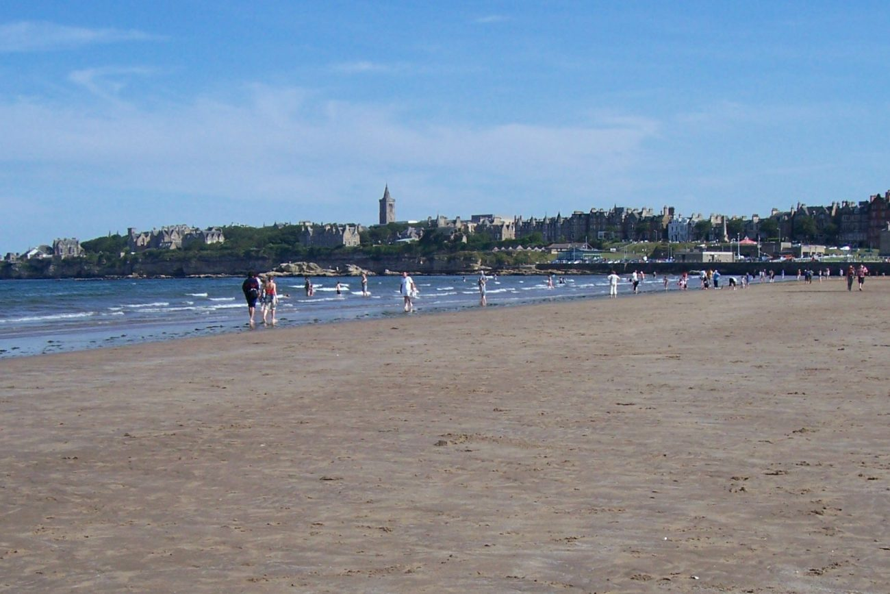 beach with st andrews town in distance