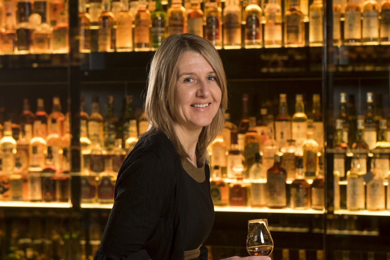 Susan with whisky collection